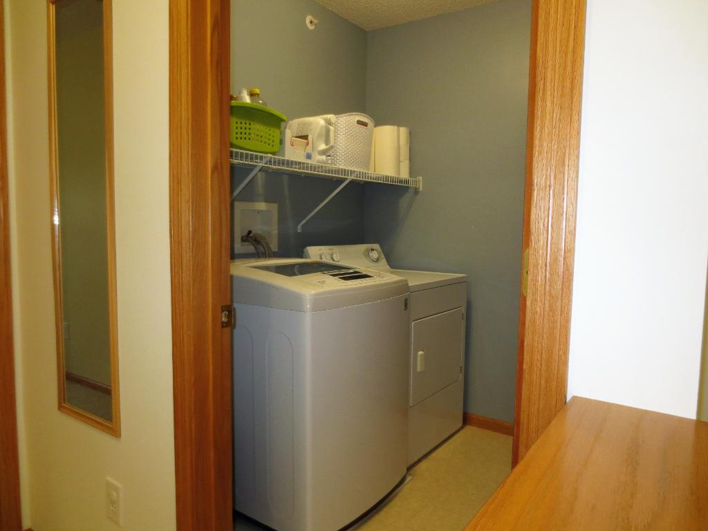 Full Size Laundry Room w/Washer & Dryer. Includes additional storage space.