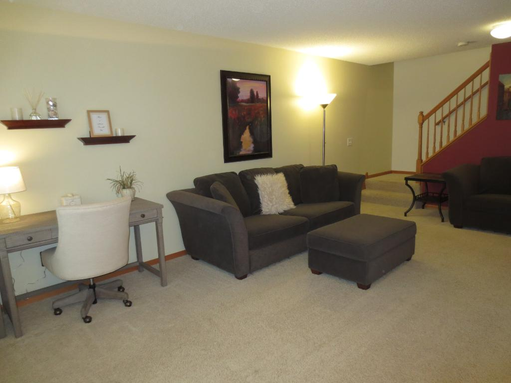 Light & bright Living Room features upgraded carpet & neutral decor!