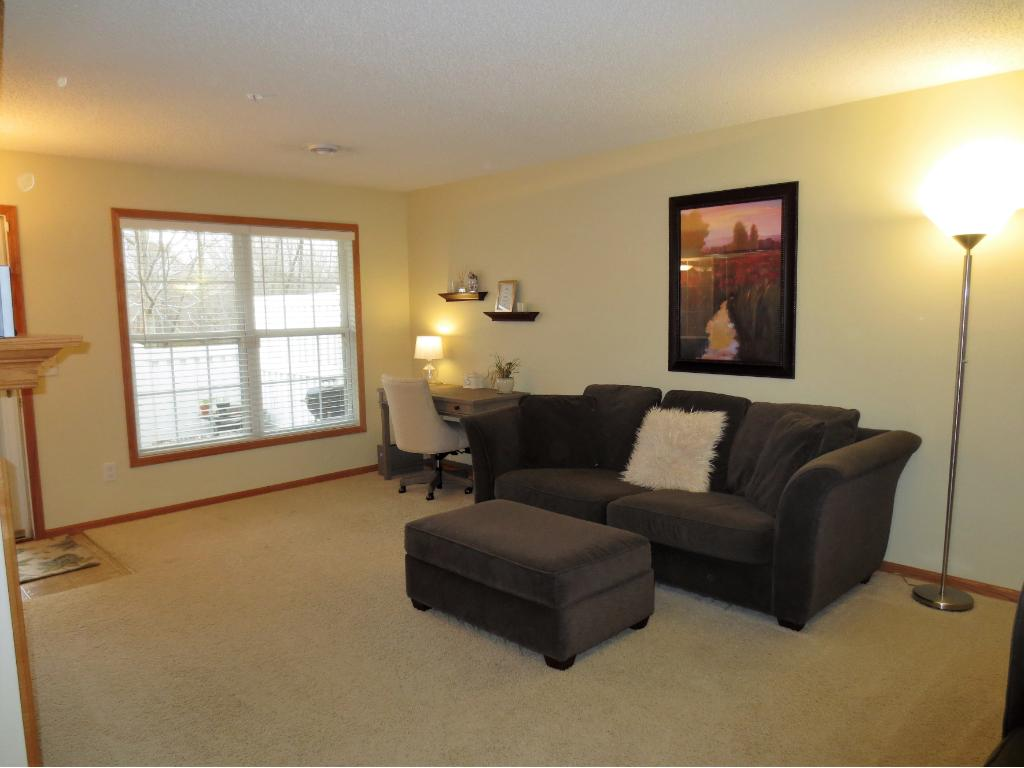 Living Room boasts large picture window. Sunny Western exposure w/Scenic Wooded Views!