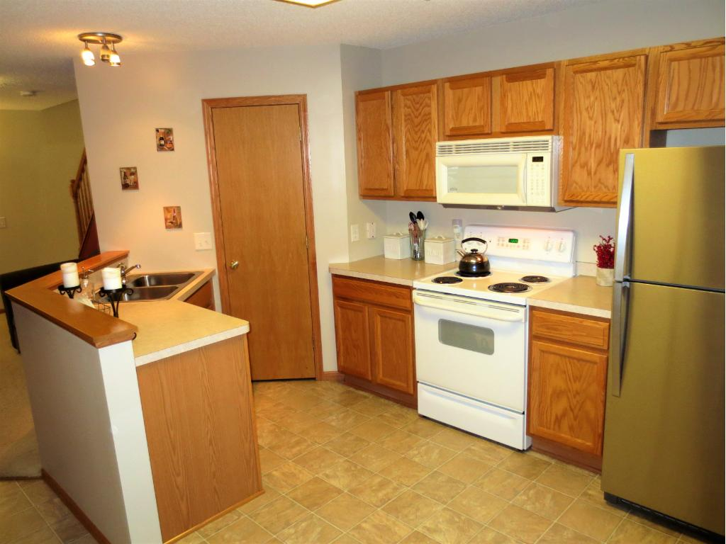 All appliances included: Range, Microwave, Brand New SS Refrigerator, SS Dishwasher & garbage disposal.