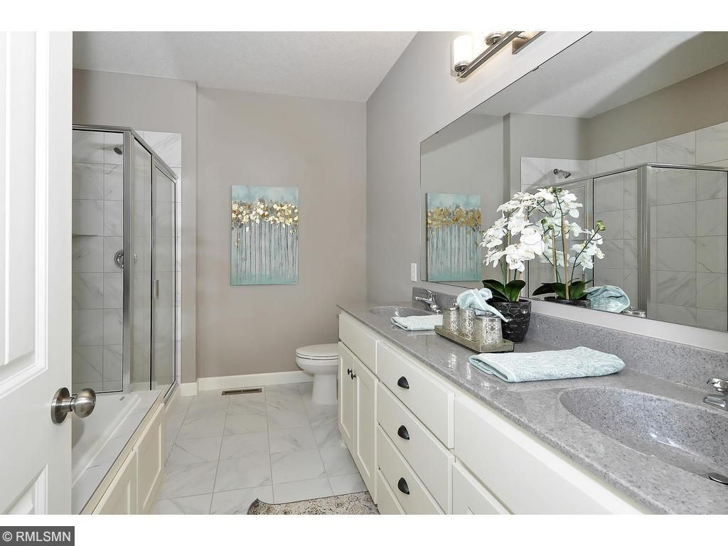 Private Master Bath with Tile Flooring and Marble Double Sinks