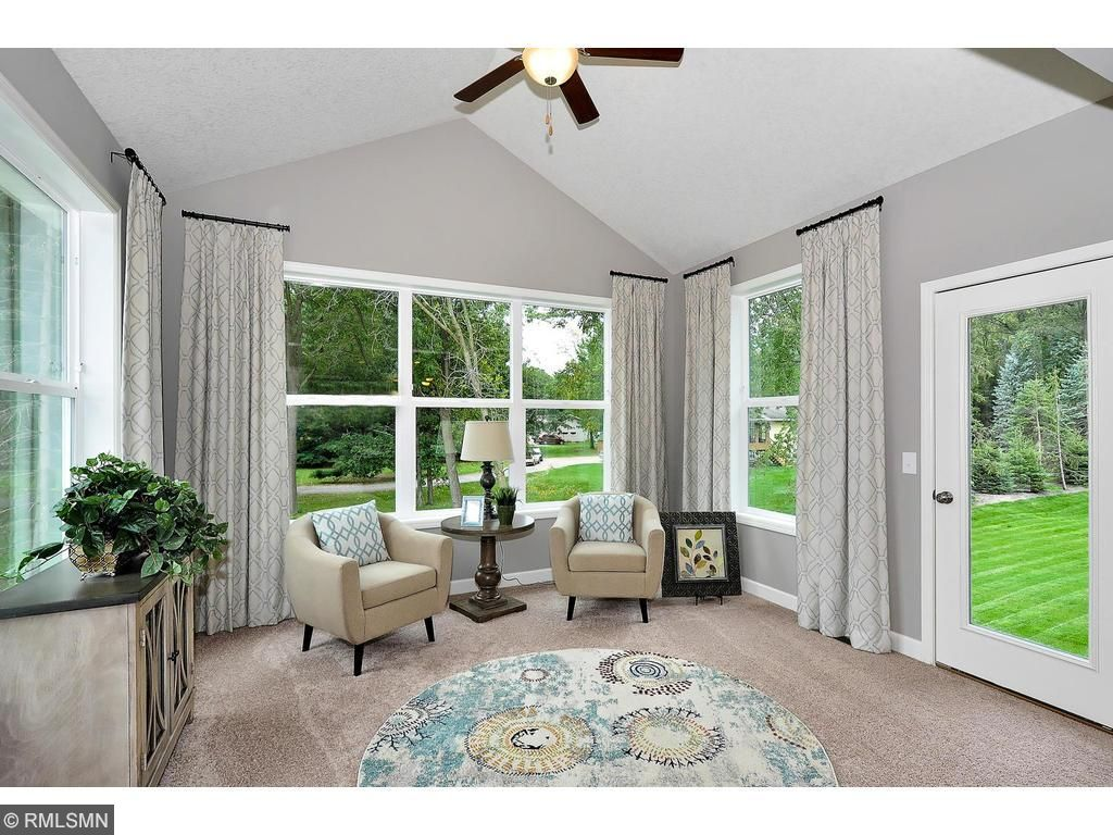 14x12 Sunroom with Vaulted Ceilings Flood the Main Level with Natural Lighting