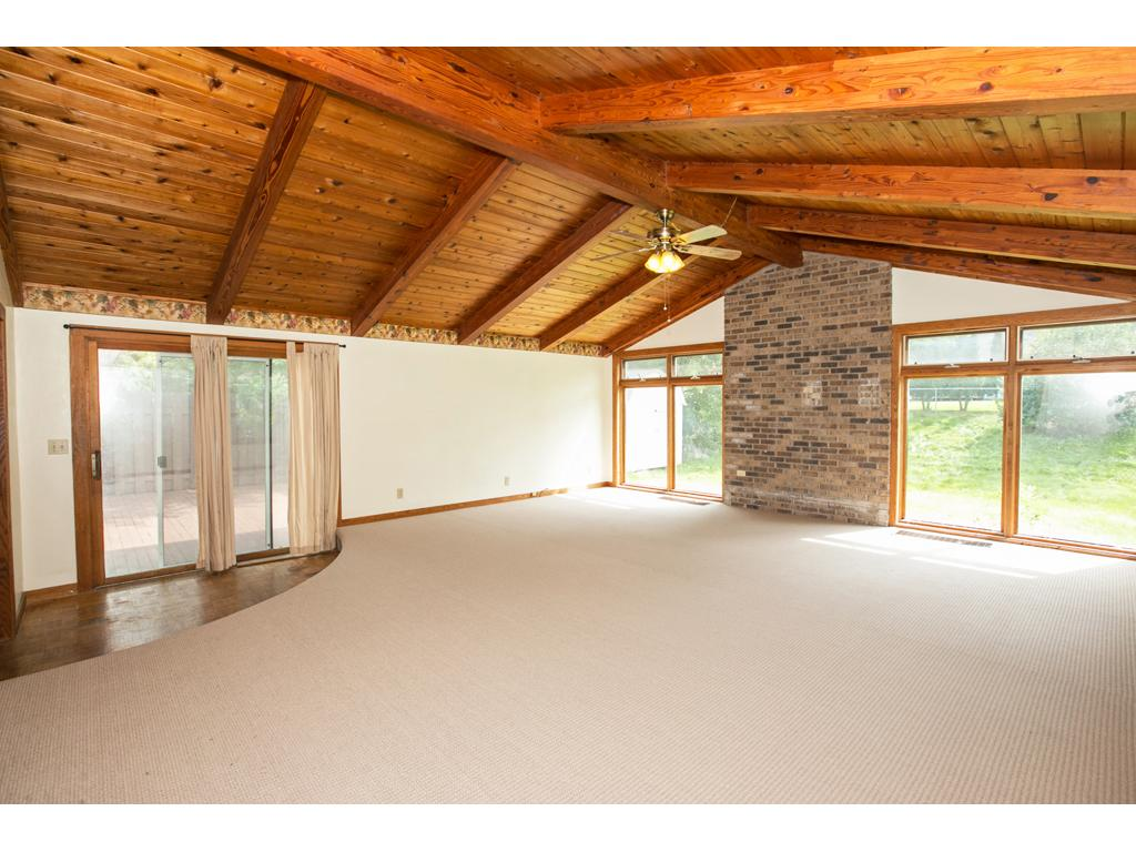 Notice the vaulted ceiling and access to deck and this family room has a full basement below the family room