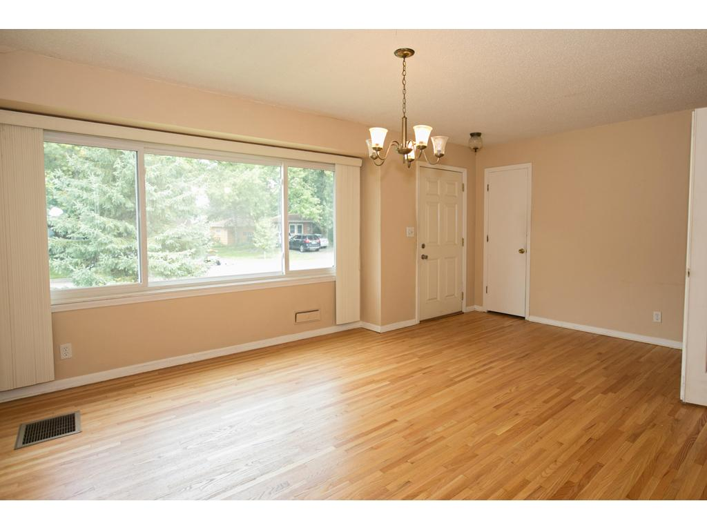 Living room or dining room, you choose, with professionally refinished (8/16) hardwood flooring