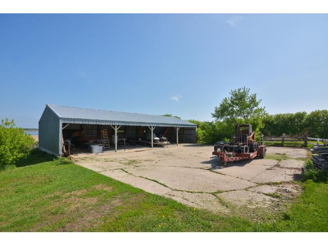 """The 64x32 open Barn/Shed has a concrete floor and a 64x50 concrete pad outside. Great place to store your seasonal """"toys""""!"""