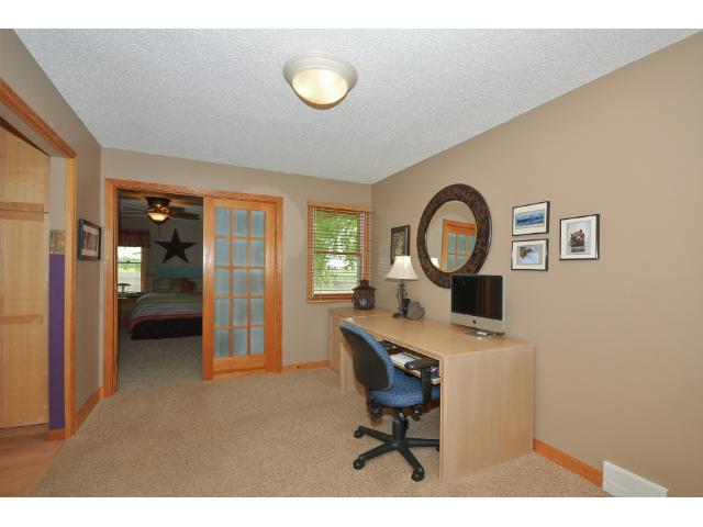 The main level Office is located off of the Kitchen and has French doors leading into the Master Suite.