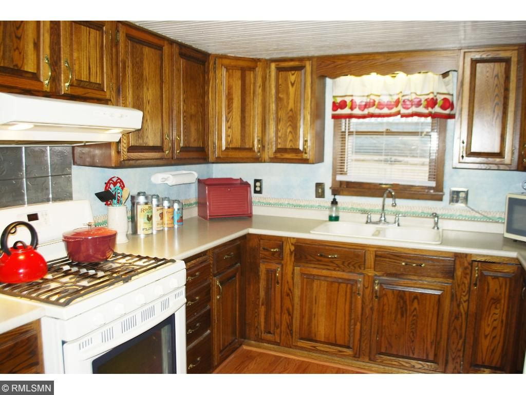 Gas stove and wooden cabinets