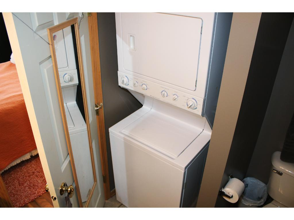 Washer and dryer are conveniently located in the master bathroom.
