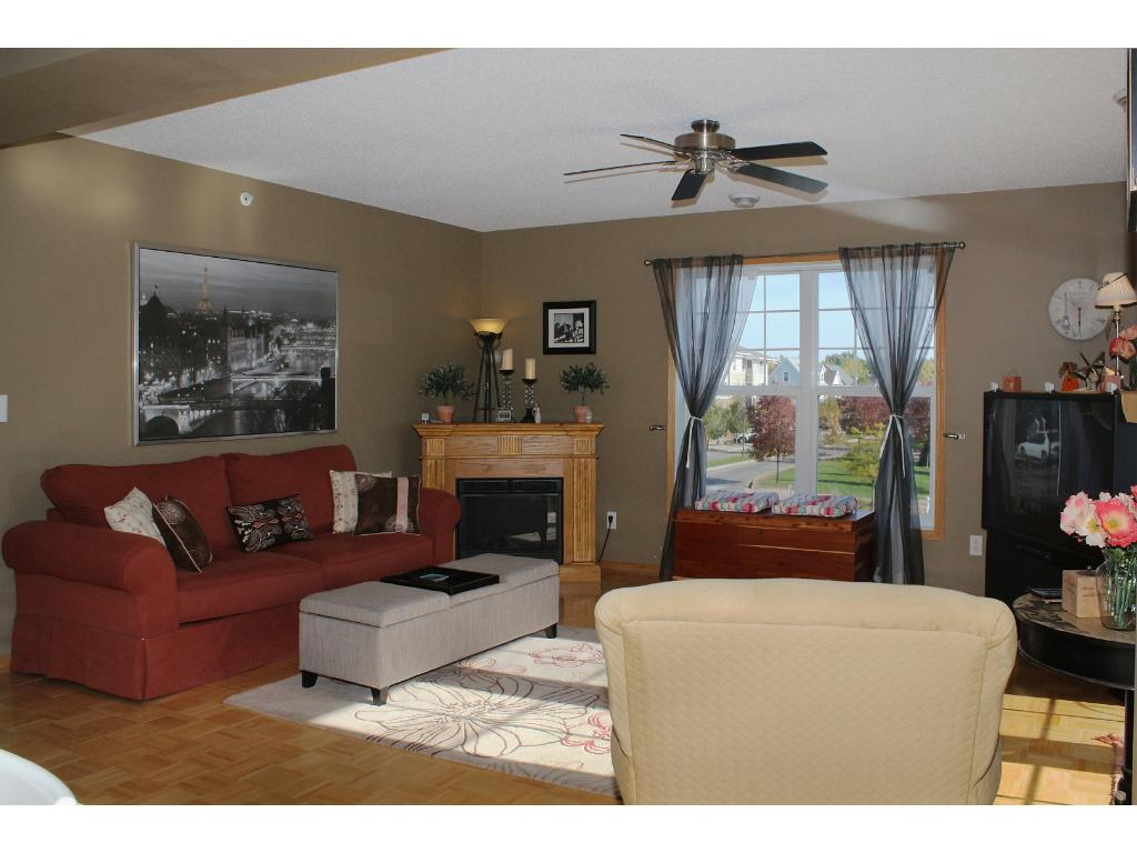 Magnificent open living room with great views all around. The large double window, huge glass door to the balcony, and ceiling fan provide for excellent air flow.