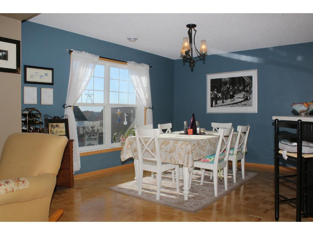 Hardwood floors glisten from abundant natural sunlight. Layout of this home allows for views from 3 walls of the house while maintaining privacy. The dining area is inviting & large. Extra seating at kitchen peninsula increases versatility of space.
