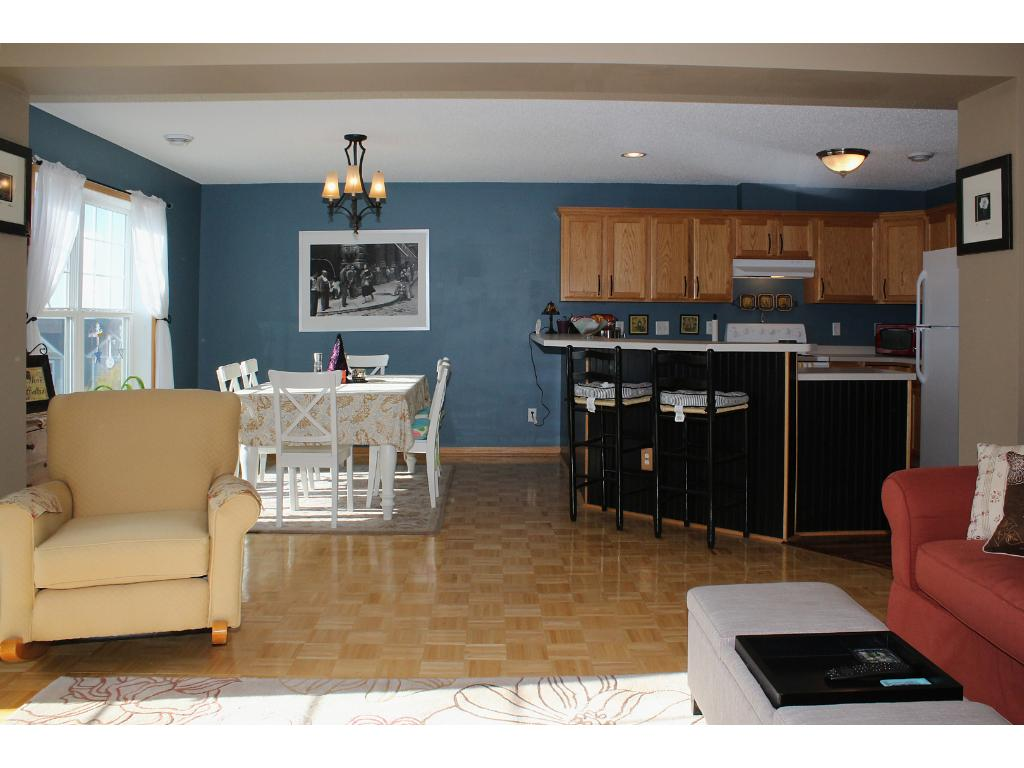 The checkbox on everyones wish list at an affordable price; Desirable OPEN CONCEPT floor plan! Let your entertaining genius flow from the huge kitchen through the living & dining room. Open the balcony doors and let the outdoors shine in.