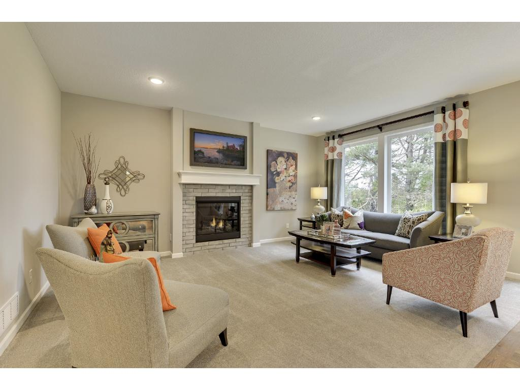 Living Room on the main level with a gas fireplace.