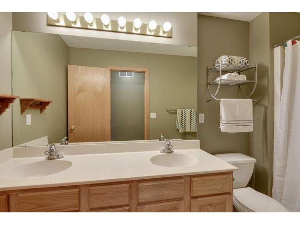 3/4 master bath with double sinks.