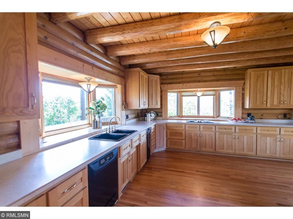 Spacious kitchen high-end appliances including Jenn-Air cooktop.