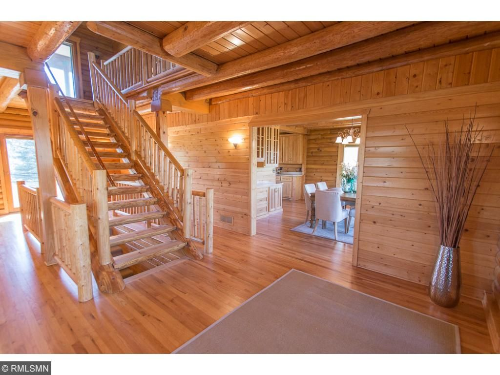 Grand entry way with open staircase and doors on each side that lead out ot the wrap around porch.