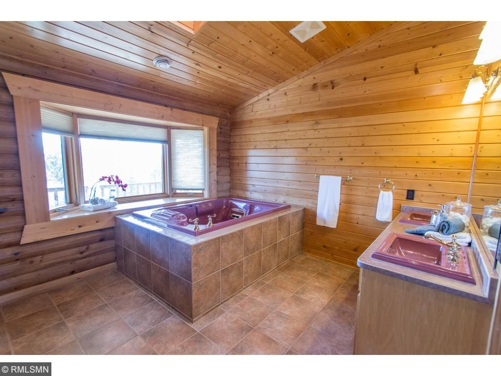 Master bath has huge soaker tub, tons of space.