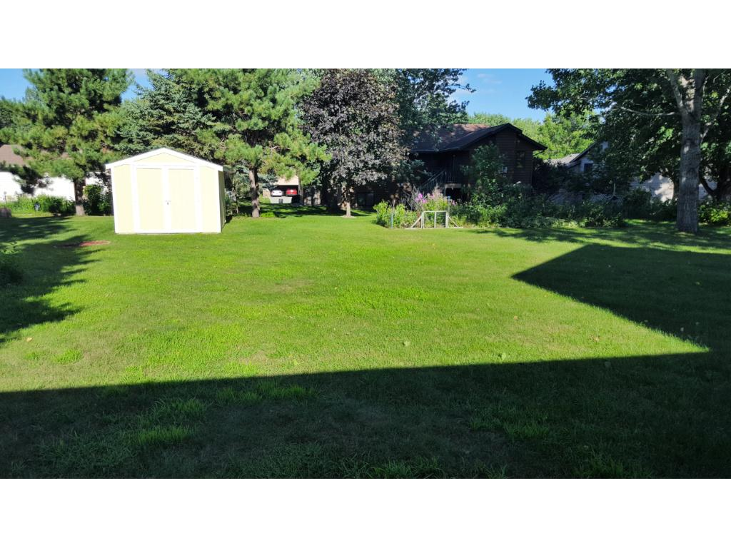 Big backyard for the kids and pets to run and play!  Mature trees provide just the right amount of shade and light!