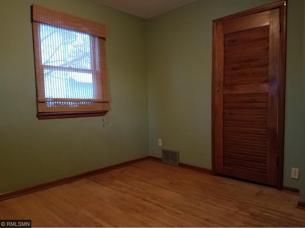 Bedroom with hardwood floors