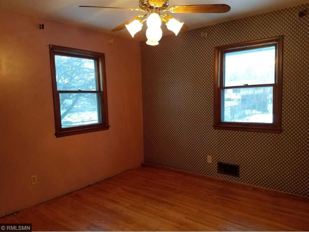 Second bedroom.  Hardwood floors and ceiling fan.
