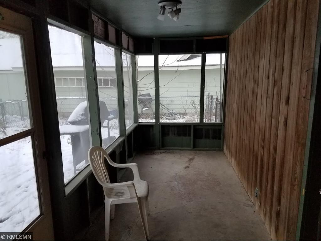 3 season porch.  Door to back yard wood deck and door to garage.