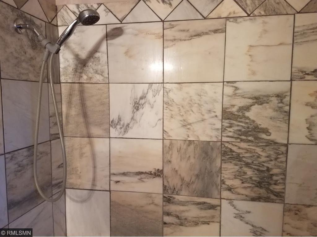 Main floor marble surround bathtub.
