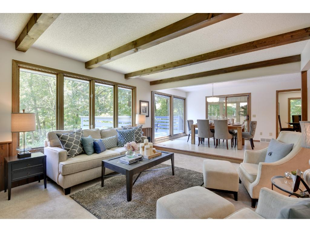 Cozy Family Room features built-ins flanking wood burning fireplace. Views from large windows feels like living in the treetops!