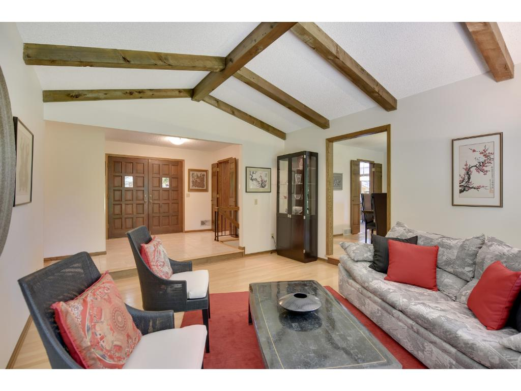 Cozy formal Living Room with views of back gardens is perfect for entertaining.
