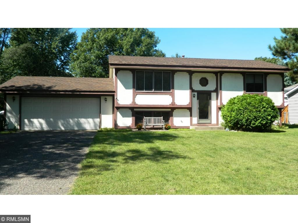 Front elevation of this 4 bedroom home located in a cul-de-sac.