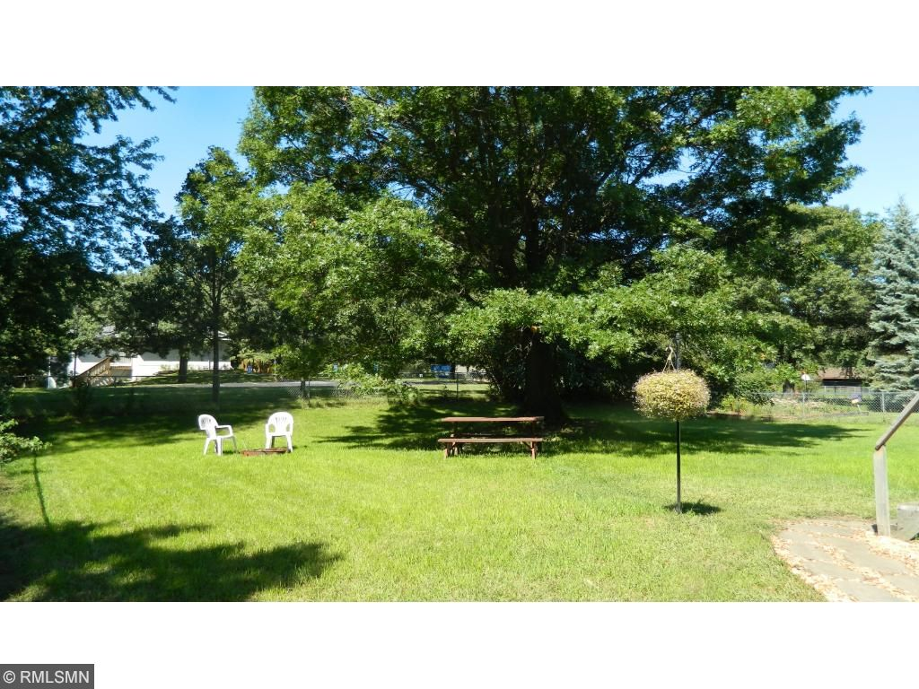 The large and very nice backyard is fully fenced and backs up to a church parking lot which offers nice privacy.