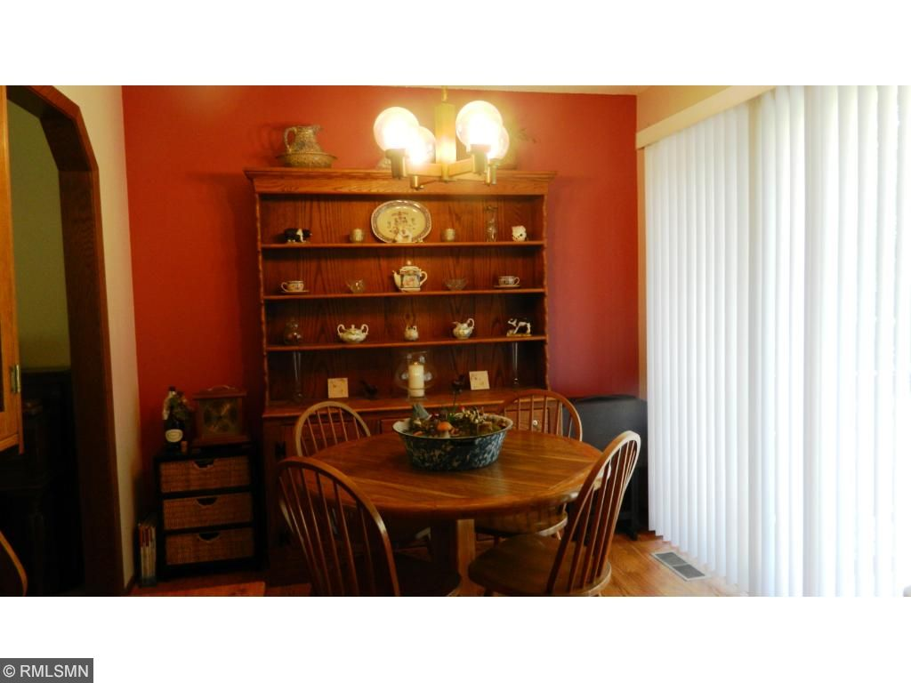 Dining room area includes patio doors out to the two tier deck and great fenced backyard.
