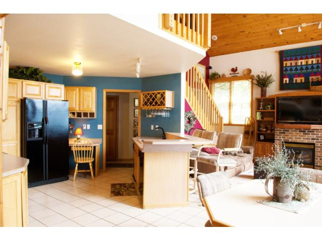 The vaulted great room includes an open kitchen, living and dining rooms. 11683 E. Point Rd., Lake Nebagamon, WI