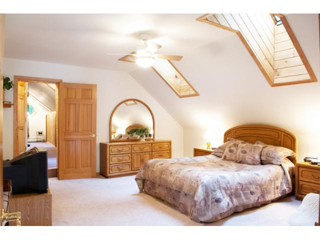 The upper level guest suite features skylights and a natural wood planked ceiling. 11683 E. Point Rd., Lake Nebagamon, WI