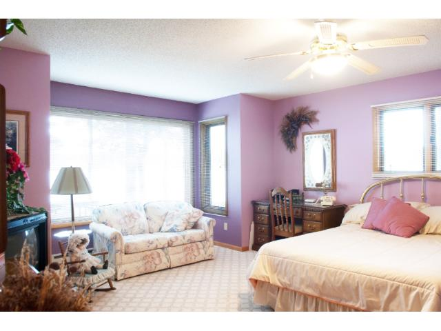 This bright main floor master suite features a large picture window with great lake views.  11683 E. Point Rd., Lake Nebagamon, WI