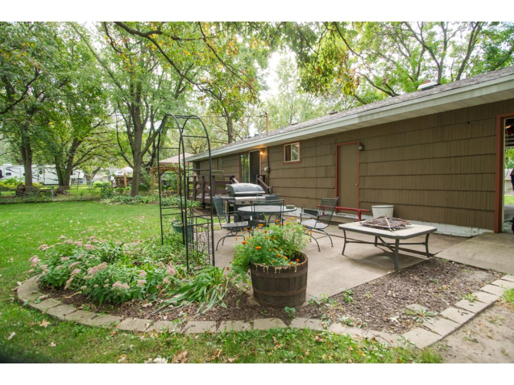 Great landscaping around patio area and garage opens to back yard