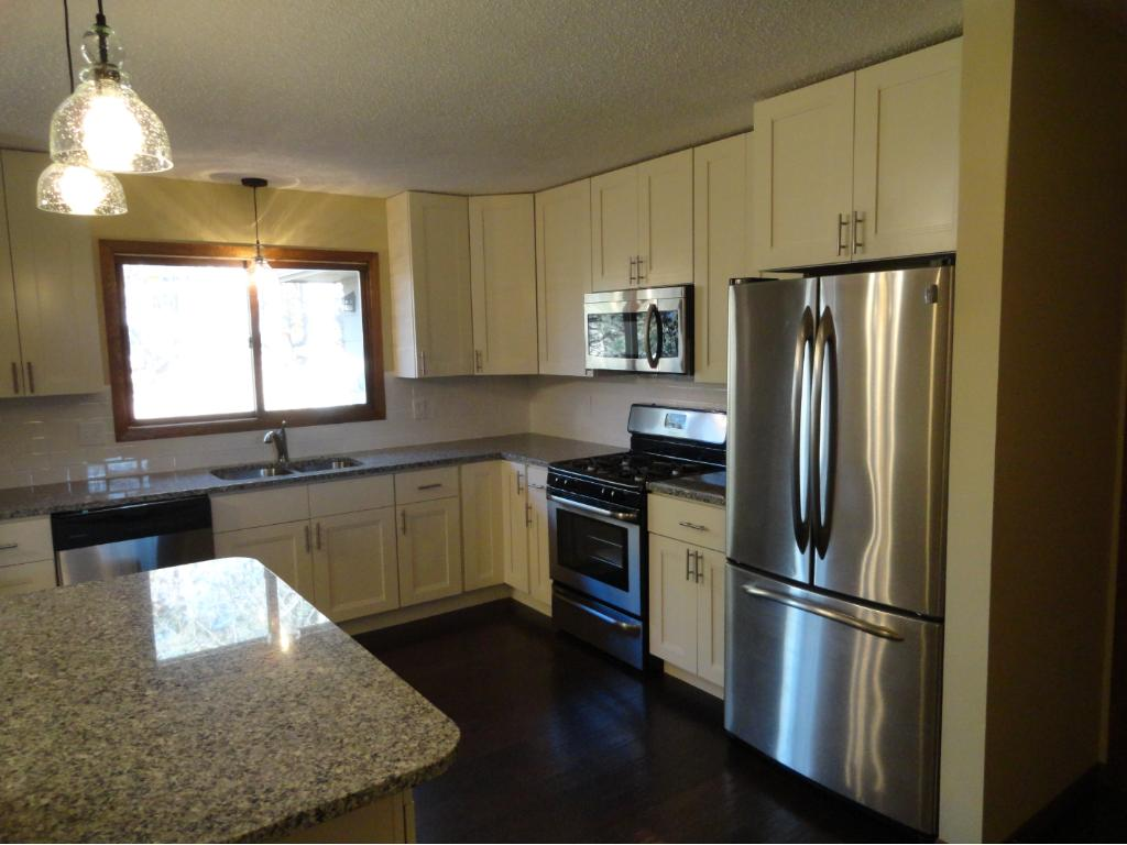 New kitchen with new cabinets, granite countertops and stainless steel appliances.