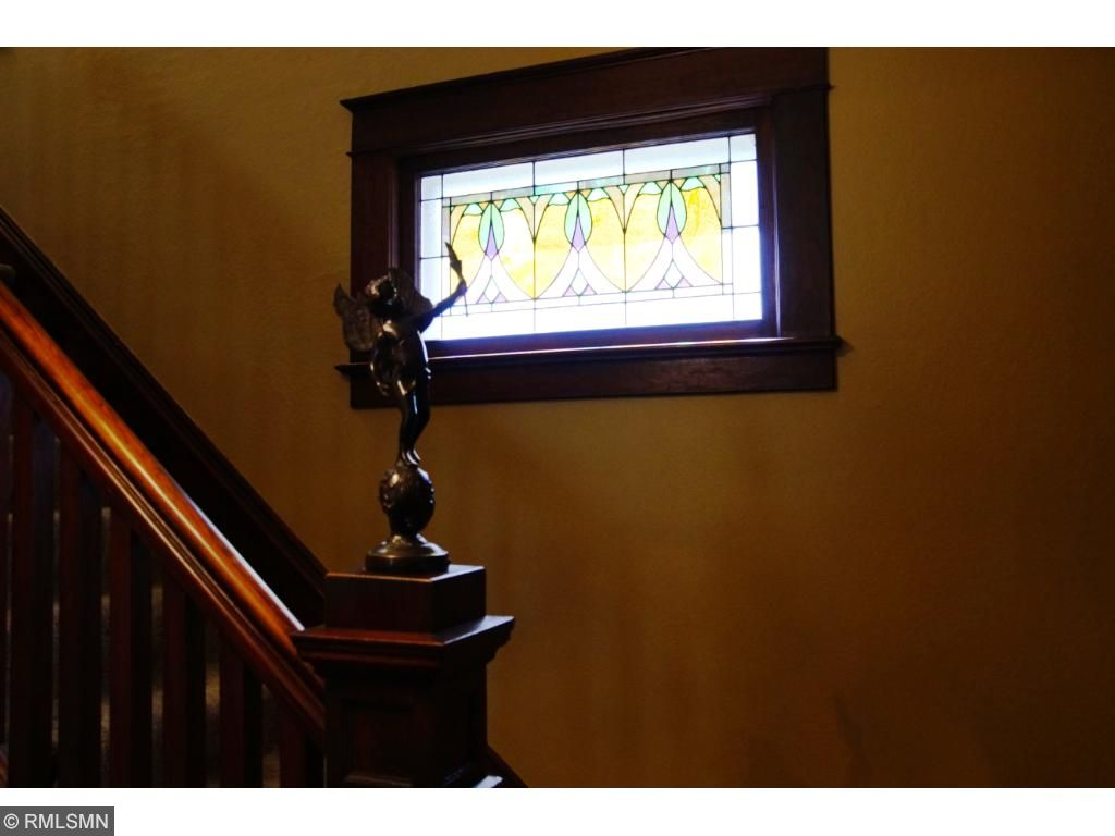 Original stained glass and beautiful banister