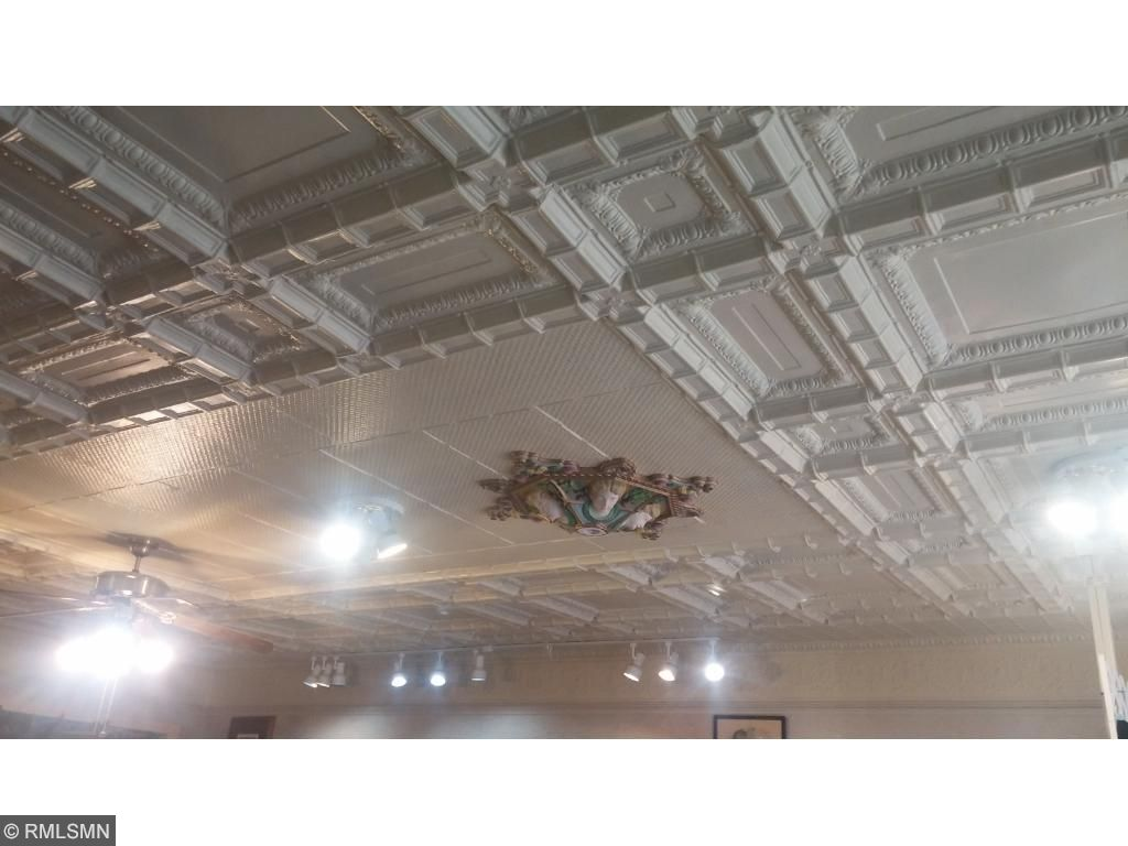 Metal detailed ceiling in main retail space.