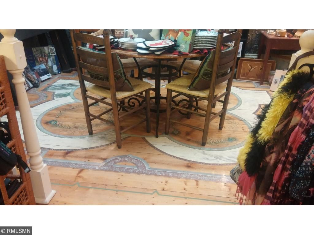 Hand painted detail on floor in side retail space.
