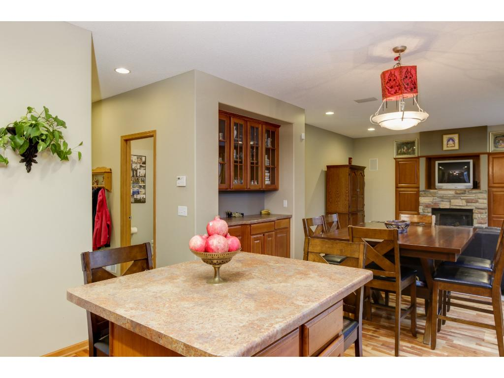 View of open floor plan of kitchen, dining area with built-in hutch & great room.