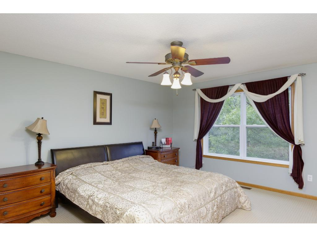 Master bedroom with views of the pond.