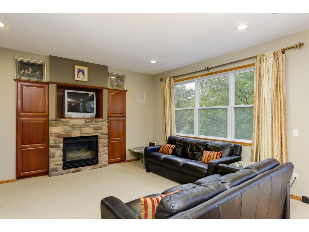 Open floor plan with great room, stone fireplace and built-in entertainment center/cabinets.