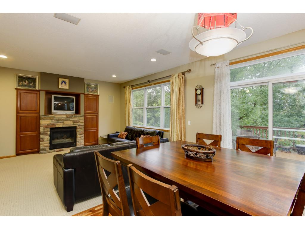 Dining area next to great room with hardwood floors.