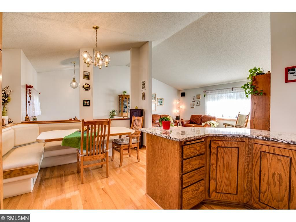 The kitchen is updated with newer appliances, granite tops, a kitchen window and breakfast area.
