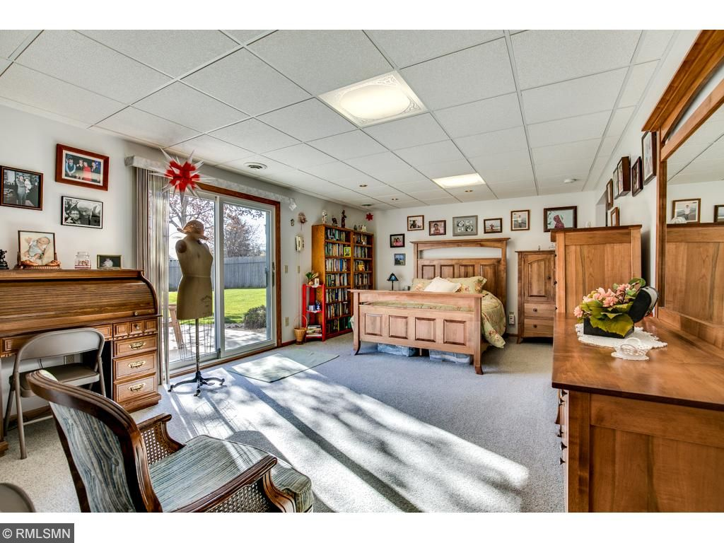 The lower level family room walks out to a fully fenced backyard and concrete patio.