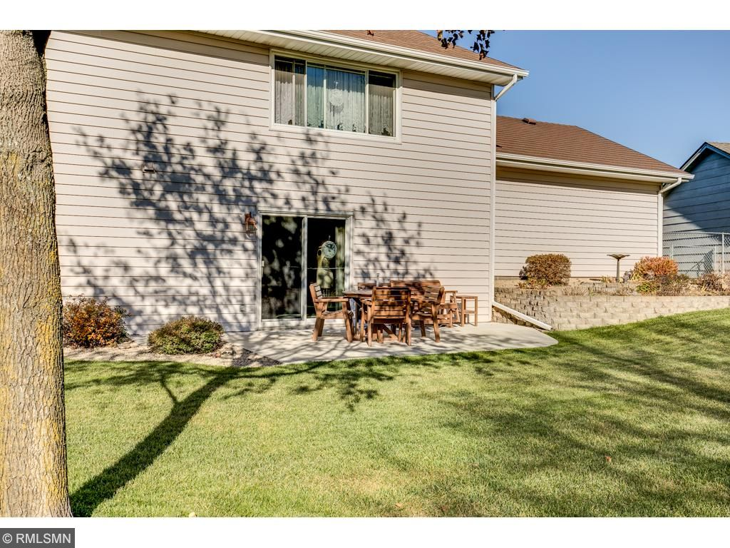 The lower level walks out to a concrete patio and large, impeccably maintained, fully fenced backyard with underground irrigation.