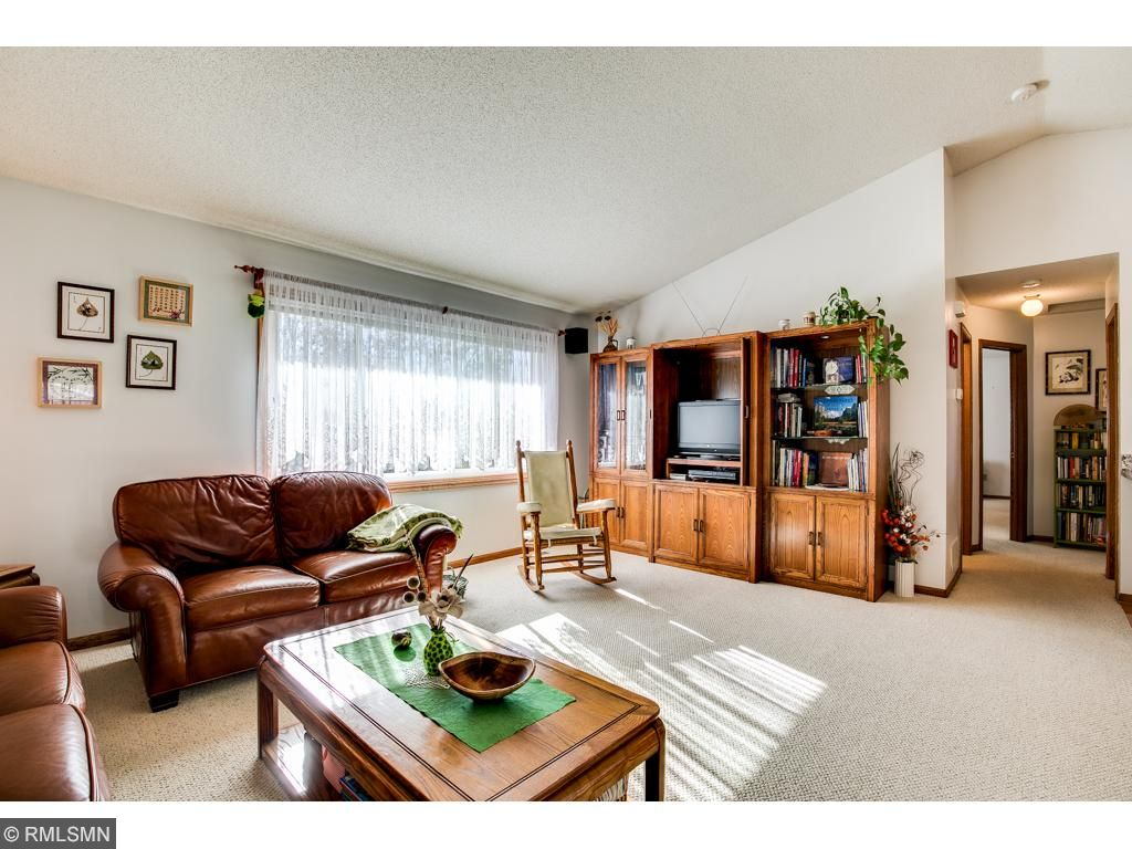 The floor plan is bright and open with vaulted ceilings and large windows.
