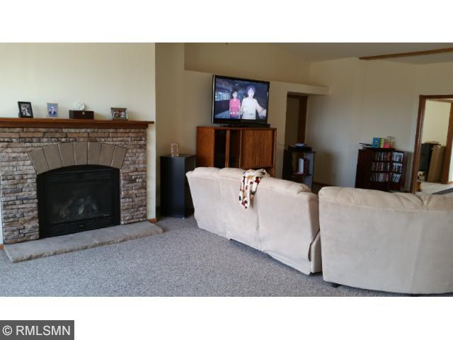 Huge 17x28 living room with gas fireplace.