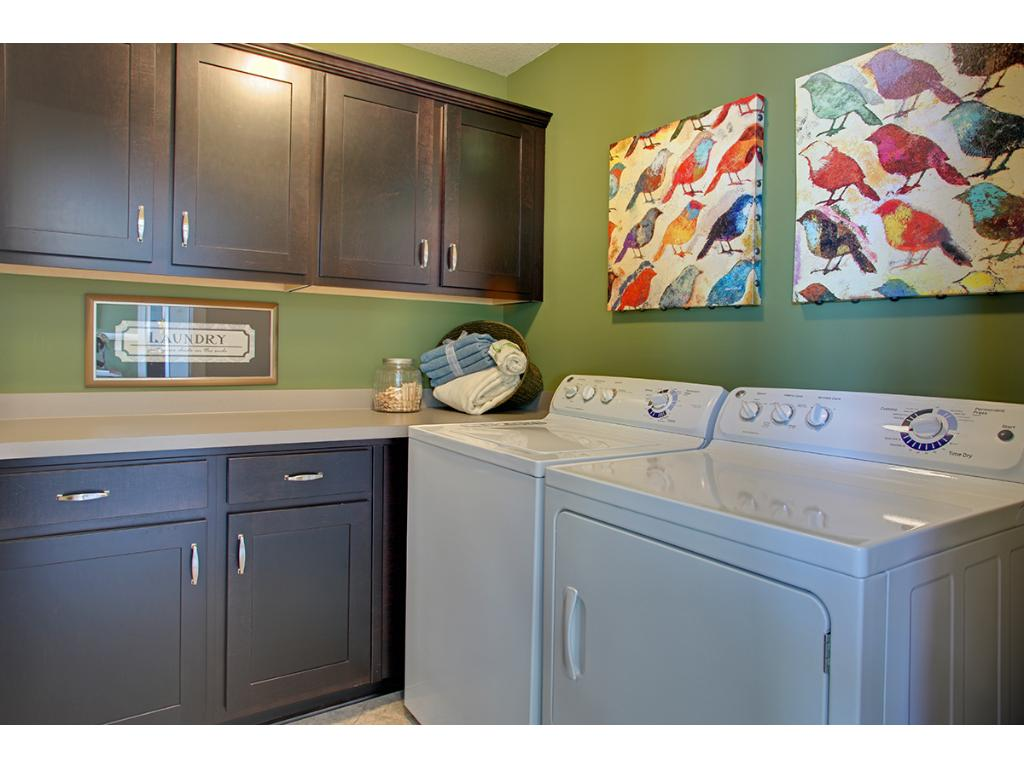 Upper level laundry in a convenient and practical location to allow busy families to better use their time, rather than toting piles of laundry up and down flights of stairs.