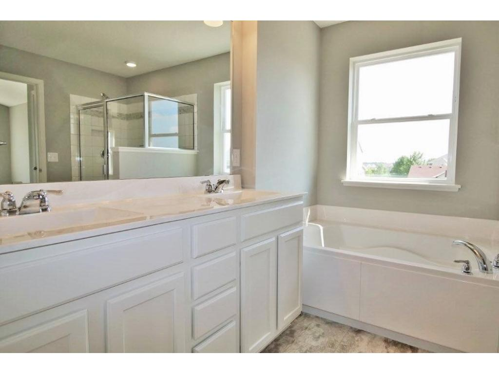 Extended double vanity, individual deep garden tub. You deserve a spa like experience and you do deserve a suite to get some rest and rejuvenation!