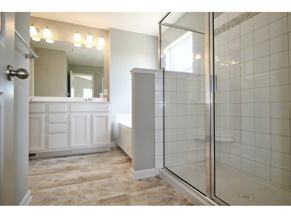 """Includes plenty of spacious room with all the features desired in a suite. 60"""", multiple shelving shower and fantastic space for separation to this owners retreat!"""